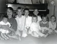 8 Children sitting together.