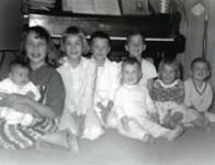 8 Children sitting together.
