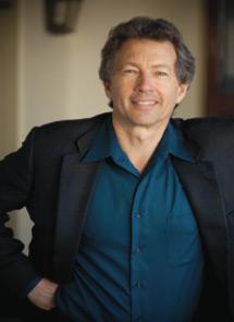 Tom North portrait in blue shirt and black blazer.