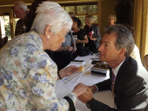 "Tom North signs his book, True North - The Shocking Truth about ""Yours, Mine and Ours"""